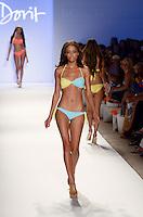 Model walks runway at Dorit Swimwear Show during Mercedes Benz IMG Fashion Swim Week 2013 at The Raleigh Hotel, Miami Beach, FL on July 23, 2012