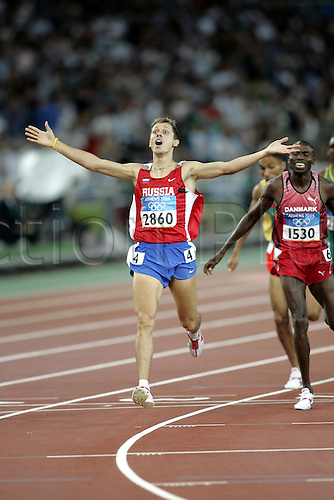 28 August 2004: Russian runner Yuriy Borzakovskiy (RUS) celebrates victory in the Men's 800m Final held at the Olympic Stadium. Borzakovskiy won in a time of 1:44.45 to become the olympic champion. 2004 Olympic Games, Athens, Greece. Photo: Neil Tingle/Action Plus...040828 olympics olympic athletics track and field athlete run running runner runs men man mens distance celebrations celebration celebrates celebrate joy celebrating