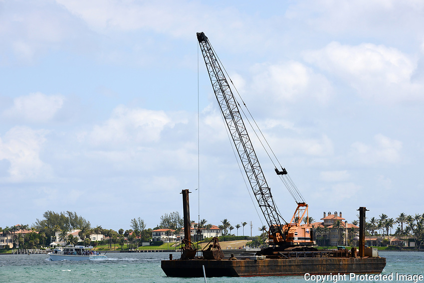 "Dredging the intracoastal channel that leads to the Boynton Beach Inlet. Some pleasure craft go astray and end up ""beached""."