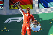25th March 2018, Melbourne Grand Prix Circuit, Melbourne, Australia; Melbourne Formula One Grand Prix, race day; Sebastian Vettel (Germany) of Ferrari celebrates his 2018 Australian Grand Prix win with a trophy lift