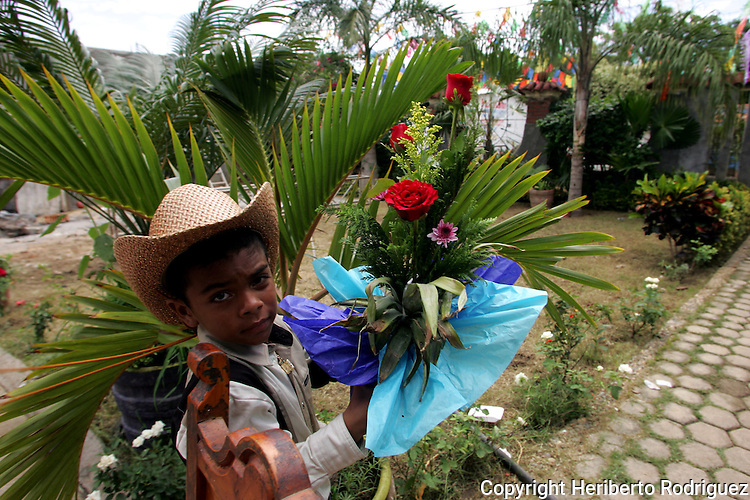 Antonio Arredondo, 8, holds a gift as he makes their way to celebrate the Santiago Apostol festivities,  one of the patron saints of this AfroMexican town of Cuajinicuilapa town, in Costa Chica in southern state of Guerrero. Photo by Heriberto Rodriguez ..