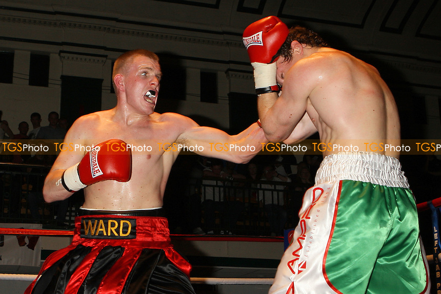 Jimmy Ward (red/black shorts) draws with Peter Vaughan in a Middleweight boxing contest at York Hall, Bethnal Green, promoted by Left Jab - 10/10/10 - MANDATORY CREDIT: Gavin Ellis/TGSPHOTO - Self billing applies where appropriate - Tel: 0845 094 6026