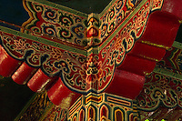 Painted and carved ceiling square in a Monastery in Sikkim, India - carved and painted pillar tops