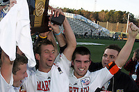Maryland seniors (l to r) Michael Dello-Russo, Chris Lancos, Jason Garey, and Kenney Bertz hold the NCAA championship trophy high, postgame. The University of Maryland defeated the University of New Mexico 1-0 in the NCAA Final at SAS Stadium in Cary, North Carolina, Sunday, December 11, 2005.