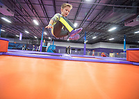 NWA Democrat-Gazette/J.T. WAMPLER Jack Jennings, 7, of Fayetteville bounces on a trampoline Sunday Feb. 11, 2018 at Altitude Trampoline Park in Fayetteville. The business opened it's doors on Saturday Feb. 10 and is open seven days a week. For information go to https://jumpaltitude.com/fayetteville/