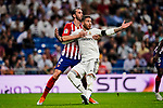 Sergio Ramos of Real Madrid (R) in action against Diego Godin Leal of Atletico de Madrid (L) during their La Liga  2018-19 match between Real Madrid CF and Atletico de Madrid at Santiago Bernabeu on September 29 2018 in Madrid, Spain. Photo by Diego Souto / Power Sport Images