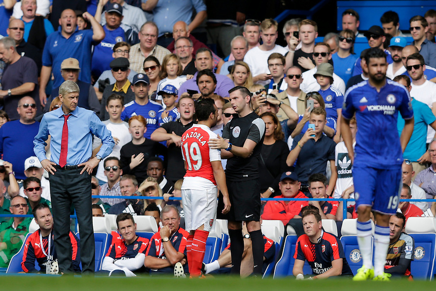 Arsenal's Santi Cazorla complains to fourth official Michael Oliver after being sent off for a second bookable offence<br /> <br /> Photographer Craig Mercer/CameraSport<br /> <br /> Football - Barclays Premiership - Chelsea v Arsenal - Saturday 19th September 2015 - Stamford Bridge - London<br /> <br /> &copy; CameraSport - 43 Linden Ave. Countesthorpe. Leicester. England. LE8 5PG - Tel: +44 (0) 116 277 4147 - admin@camerasport.com - www.camerasport.com