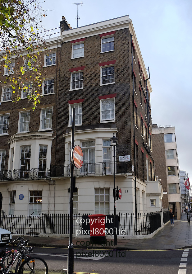 Pic shows: side of 33 Montagu Place - home of Scot Young<br /> <br /> He actually fell or was pushed into Montagu Square onto railings.<br /> <br /> Believed to fall from top floor window<br /> <br /> <br /> Also Death scene of Scot Young - ex husband of Michelle Young.<br /> <br /> Grieving friends and mourners left flowers and notes today. 11.12.14<br /> <br /> <br /> <br /> <br /> Pic by Gavin Rodgers/Pixel 8000 Ltd