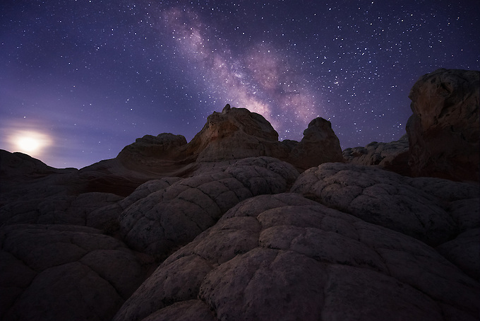 The milky way and rising moon add a subtle glow to this unique landscape in the remote Arizona desert.