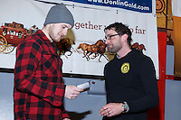 Wade Marrs recieves the Nome Kennel Club fastest time from from Safety award from Tom Jamgochian at the finishers banquet in Nome on Sunday  March 22, 2015 during Iditarod 2015.  <br /> <br /> (C) Jeff Schultz/SchultzPhoto.com - ALL RIGHTS RESERVED<br />  DUPLICATION  PROHIBITED  WITHOUT  PERMISSION