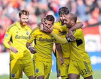 Ben Speas (17) of the Columbus Crew celebrates his goal with teammates Agustin Viana (24) and Federico Higuain (33) during the game at RFK Stadium in Washington, DC.  Columbus Crew defeated D.C. United, 2-1.