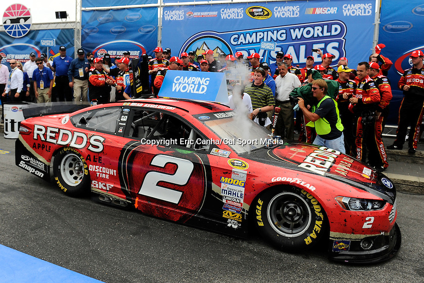 July 13, 2014 - Loudon, New Hampshire, U.S. - Sprint Cup Series driver Brad Keselowski (2) pulls into Victory Lane after winning the NASCAR Sprint Cup Series Camping World RV 301 race held at the New Hampshire Motor Speedway in Loudon, New Hampshire.   Eric Canha/CSM
