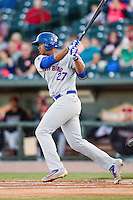 South Bend Cubs designated hitter Eloy Jimenez (27) follows through on his swing against the Great Lakes Loons on May 18, 2016 at Dow Diamond in Midland, Michigan. Great Lakes defeated South Bend 5-4. (Andrew Woolley/Four Seam Images)