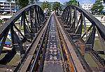 A perspective view of the Bridge Over the River Kwai that really exists and still carries regular passenger trains from Bangkok to other parts of Thailand.