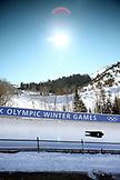 USA, Utah, Park City, a skeleton races high around turn 12 at Utah Olympic Park