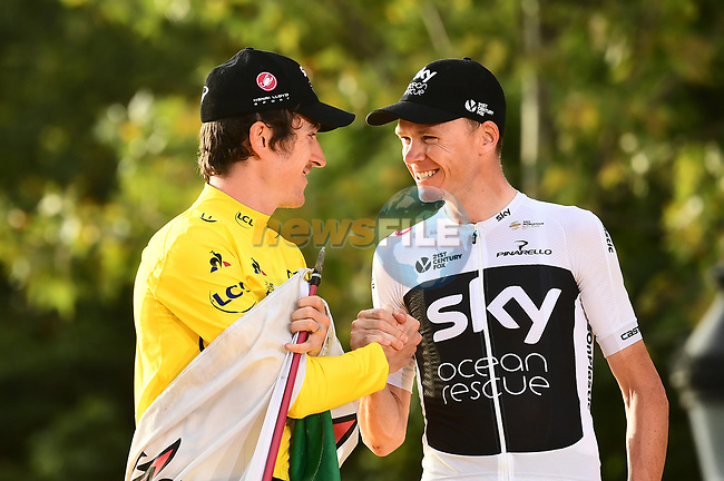 Overall winner Yellow Jersey Geraint Thomas (WAL) and 3rd place Chris Froome Team Sky congratulate one another on the podium at the end of Stage 21 of the 2018 Tour de France running 116km from Houilles to Paris Champs-Elysees, France. 29th July 2018. <br /> Picture: ASO/Alex Broadway | Cyclefile<br /> All photos usage must carry mandatory copyright credit (© Cyclefile | ASO/Alex Broadway)