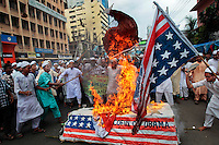 "Bangladeshi Muslims burn a U.S. flag and a coffin of U.S. President Barack Obama during a protest in Dhaka, Bangladesh. The protest was against an anti-Islam film called ""Innocence of Muslims"" that ridicules Islam's Prophet Muhammad."