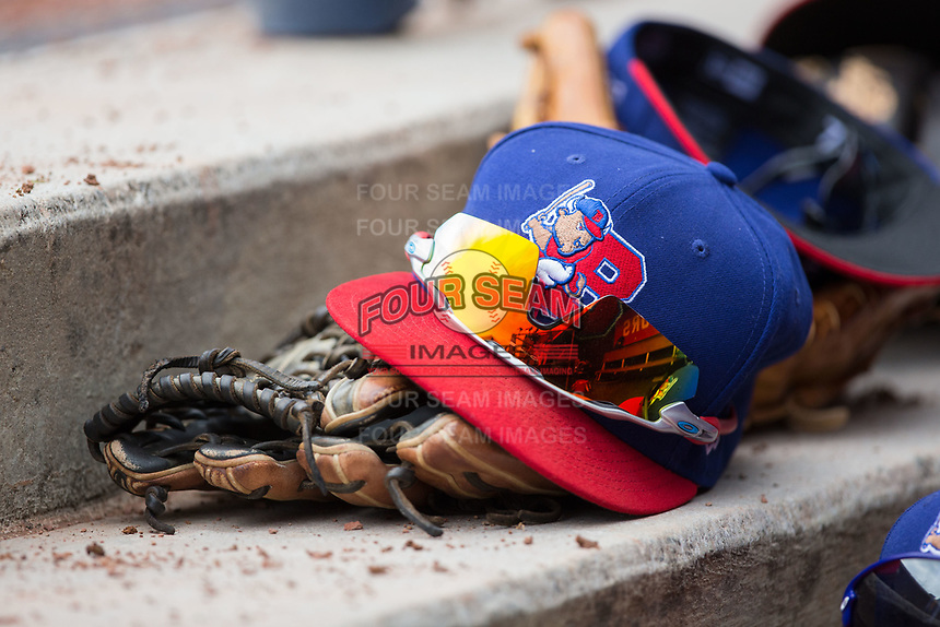 A Buffalo Bisons cap sits on top of a glove in the visitor's dugout during the game against the Durham Bulls at Durham Bulls Athletic Park on April 30, 2017 in Durham, North Carolina.  The Bisons defeated the Bulls 6-1.  (Brian Westerholt/Four Seam Images)