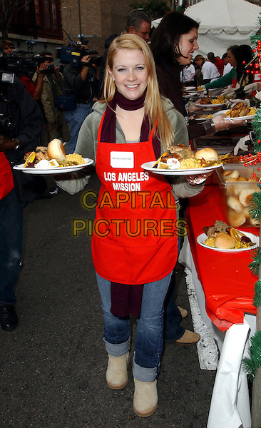MELISSA JOAN HART.volunteer as The Los Angeles Mission Serve Up Holiday Cheer for the Homeless of Skid Row in Downtown Los Angeles, California on Christmas Eve .24 December 2003  .**UK Sales Only**     .full length, full-length, food, apron, ugg boots .www.capitalpictures.com.sales@capitalpictures.com.©Capital Pictures.