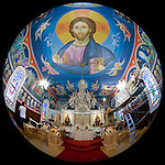 St. Sava frescos by Miloje Milinkovic, interior of this historic St. Sava Serbian Orthodox Church--Pantocrator of Jesus Christ is the centerpiece in the middle of the ceiling. His assistant, Slobodan Kikovich paints the border on the left.  Jackson, Calif.