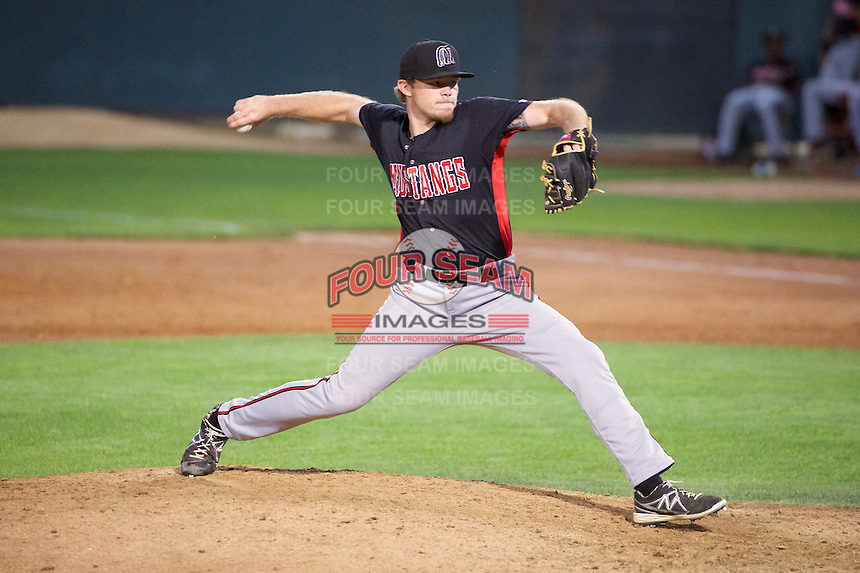 Jeremy Kivel (21) of the Billings Mustangs delivers a pitch to the plate against the Orem Owlz in Pioneer League action at Home of the OWLZ on August 15, 2014 in Orem , Utah.  (Stephen Smith/Four Seam Images)
