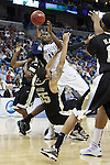 Freshman guard John Wall gets dragged down while taking a shot during the second half of UK's second round  win, 90-60 over Wake Forest in the NCAA tournament at New Orleans Arena on Saturday, March 20, 2010. Photo by Britney McIntosh | Staff