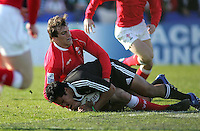 New Zealand out half Trent Renata is tackled by Welsh skipper Sam Warburton during the Division A clash against Wales at Ravenhill. Result New Zealand 37 Wales 14.
