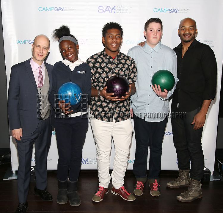 Taro Alexander and Brandon Victor Dixon with (SAY) kids attend the 5th Annual Paul Rudd All-Star Bowling Benefit for (SAY) at Lucky Strike Lanes on February 13, 2017 in New York City.