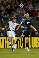 Stephen McCarthy (left) and Steven Lenhart (right) go up for the header. The San Jose Earthquakes defeated the New England Revolution 2-1 at Buck Shaw Stadium in Santa Clara, California on May 21st, 2011.