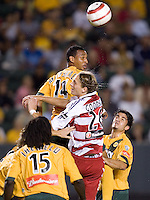 Tyrone Marshall and Clarence Goodson collide for a header in the US Open Cup at the Home Depot Center, in Carson, Calif., Wednesday, September 28, 2005.