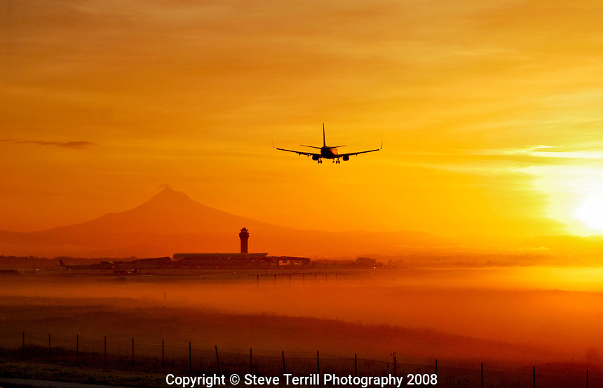 Airplane landing at PIA in Portland Oregon