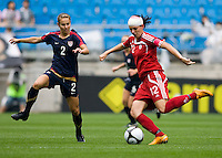 USWNT defender (2) Heather Mitts closes in on Canada's (12) Christine Sinclair during the finals of the Peace Queen Cup.  The USWNT defeated Canada, 1-0, at Suwon World Cup Stadium in Suwon, South Korea.