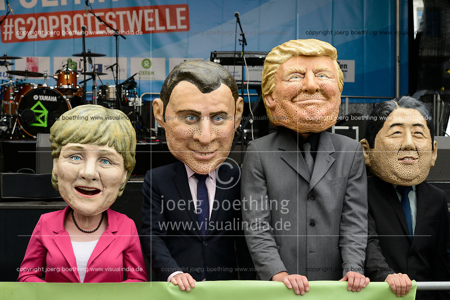 GERMANY, Hamburg, protest rally against G-20 summit in july 2017, mask of the G20 politicians in chief like Angela Merkel, Donald Trump  / DEUTSCHLAND, Hamburg, Protest Demo gegen G20 Gipfel in Hamburg