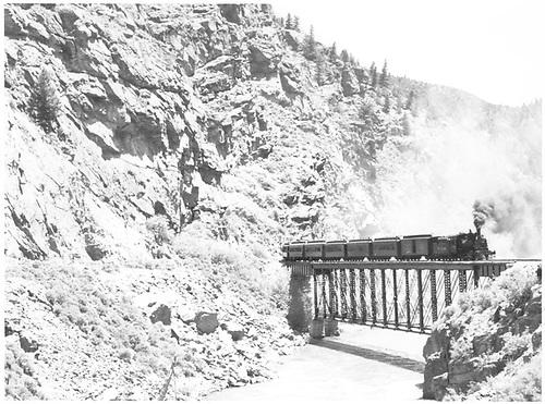 Crystal Creek Bridge with excursion train crossing Gunnison River.<br /> D&amp;RGW  Black Canyon, CO  Taken by Richardson, Robert W. - 5/30/1949