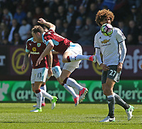 Burnley's Ashley Barnes is fouled by Manchester United's Marouane Fellaini<br /> <br /> Photographer Stephen White/CameraSport<br /> <br /> The Premier League - Burnley v Manchester United - Sunday 23rd April 2017 - Turf Moor - Burnley<br /> <br /> World Copyright &copy; 2017 CameraSport. All rights reserved. 43 Linden Ave. Countesthorpe. Leicester. England. LE8 5PG - Tel: +44 (0) 116 277 4147 - admin@camerasport.com - www.camerasport.com