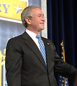 United States President George W. Bush addresses the Brigade of Midshipmen at the U.S. Naval Academy in Annapolis, MD on November 30, 2005. The President spoke on the current status on the War on Terrorism and plan for victory. <br /> Credit: US Navy via CNP