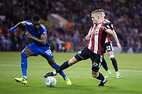 Paul Coutts of Sheffield United brings the ball away from Daniel Amartey of Leicester City during the Carabao Cup match between Sheffield United and Leicester City at Bramall Lane, Sheffield, England on 22 August 2017. Photo by James Williamson / PRiME Media Images.