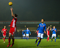 Walsall's Jon Guthrie (left) tries to stop the ball with his hand as Rochdale's Joe Thompson (right) looks on during the Sky Bet League 1 match between Rochdale and Walsall at Spotland Stadium, Rochdale, England on 23 December 2017. Photo by Juel Miah / PRiME Media Images.