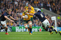 Kane Douglas of Australia forces his way past Blair Cowan and Jonny Gray of Scotland during the Quarter Final of the Rugby World Cup 2015 between Australia and Scotland - 18/10/2015 - Twickenham Stadium, London<br /> Mandatory Credit: Rob Munro/Stewart Communications