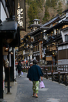 Visitors walking down the main street. Ginzan Onsen, Yamagata Prefecture, Japan, April 12, 2016. Once a sliver-mining town, Ginzan Onsen in Yamagata Prefecture is now one of Japan's best-known and most picturesque hot spring resorts. Its Taisho-period architecture and retro atmosphere is said to have been an inspiration for Hayao Miyazaki's Oscar-winning animated film, Spirited Away.