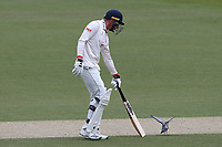 Daniel Lawrence of Essex tries to move a pigeon off of the wicket during Surrey CCC vs Essex CCC, Specsavers County Championship Division 1 Cricket at the Kia Oval on 12th April 2019