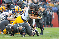 Baltimore, MD - December 10, 2016: Army Black Knights running back Andy Davidson (40) gets tackled during game between Army and Navy at  M&T Bank Stadium in Baltimore, MD.   (Photo by Elliott Brown/Media Images International)