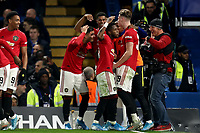 30th October 2019; Stamford Bridge, London, England; English Football League Cup, Carabao Cup, Chelsea Football Club versus Manchester United; Marcus Rashford of Manchester Utd celebrates with team mates as he scores for 1-2 in the 73rd minute - Strictly Editorial Use Only. No use with unauthorized audio, video, data, fixture lists, club/league logos or 'live' services. Online in-match use limited to 120 images, no video emulation. No use in betting, games or single club/league/player publications