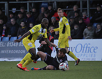 Isaac Osbourne beats a grounded Richie Brittain in the Ross County v St Mirren Scottish Professional Football League match played at the Global Energy Stadium, Dingwall on 17.1.15.
