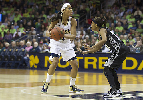 January 26, 2013:  Notre Dame guard Skylar Diggins (4) goes up for a shot as Providence guard Symone Roberts (12) defends during NCAA Basketball game action between the Notre Dame Fighting Irish and the Providence Friars at Purcell Pavilion at the Joyce Center in South Bend, Indiana.  Notre Dame defeated Providence 89-44.