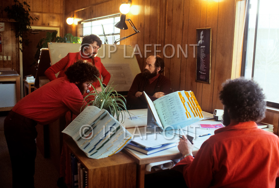 Wasco, Oregon, February 1984: Disciples of Bhagwan Rajneesh working in an administrative office in Rajneeshpuram.  Rajneeshpuram, was an intentional community in Wasco County, Oregon, briefly incorporated as a city in the 1980s, which was populated with followers of the spiritual teacher Osho, then known as Bhagwan Shree Rajneesh. The community was developed by turning a ranch from an empty rural property into a city complete with typical urban infrastructure, with population of about 7000 followers.
