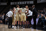 Wake Forest Demon Deacons head coach Jen Hoover talks strategy with her team during a second half timeout in the game against the Notre Dame Fighting Irish at the LJVM Coliseum on December 31, 2017 in Winston-Salem, North Carolina.  The Fighting Irish defeated the Demon Deacons 96-73.  (Brian Westerholt/Sports On Film)