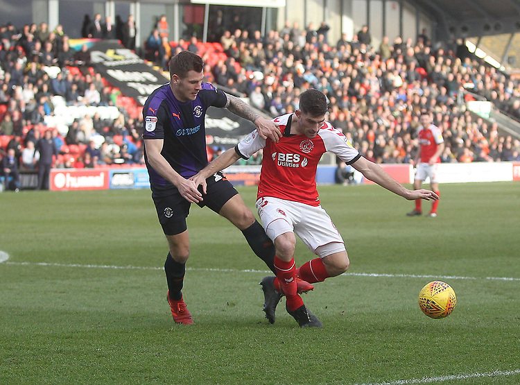 Fleetwood Town's Ched Evans battles with Luton Town's James Collins<br /> <br /> Photographer Mick Walker/CameraSport<br /> <br /> The EFL Sky Bet League One - Fleetwood Town v Luton Town - Saturday 16th February 2019 - Highbury Stadium - Fleetwood<br /> <br /> World Copyright © 2019 CameraSport. All rights reserved. 43 Linden Ave. Countesthorpe. Leicester. England. LE8 5PG - Tel: +44 (0) 116 277 4147 - admin@camerasport.com - www.camerasport.com