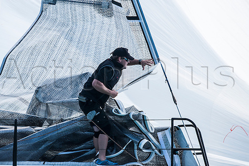 21.01.2013. Key West, Florida, USA.  Interlodge crew member in action during day one at the Quantum Key West Race Week  Key West, Florida, USA.