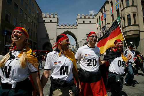Jun 9, 2006; Munich, GERMANY; Germany supporters Sarah Boeckeler and Oliver Mayerle from Cologne Germany and Jan Mayerle and Stefanie Santner of Basel Switzerland walk through downtown Munich during the opening day of the World Cup. Germany plays Costa Rica in Munich and Poland plays Ecuador in Gelsenkirchen in Group A first round action. Mandatory Credit: Ron Scheffler-US PRESSWIRE Copyright © Ron Scheffler